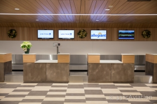 United and Allegiant ticket counters.